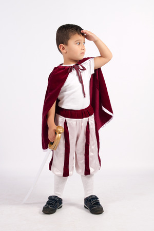 medieval warrior: Boy dressed in an oblique Prince, holding in his hand a sword