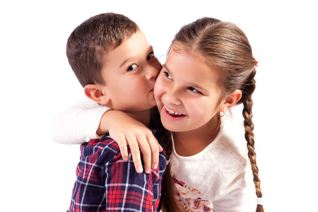 Brother and sister in a hug, smiling