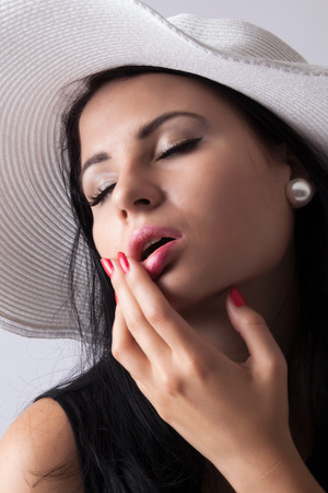 dreamy: Young dreamy lady in hat Stock Photo