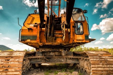 Large industrial yellow machine closeup photo