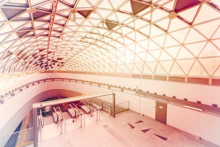 Interior of a modern subway station, sunshine