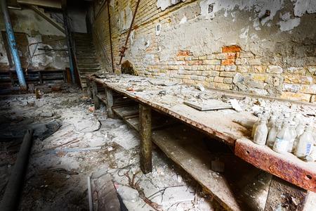 an old empty desolate dirty locksmith workshop, poor light