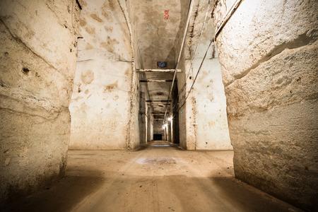 corridors: an old abandoned limestone mine corridors, poor light Stock Photo