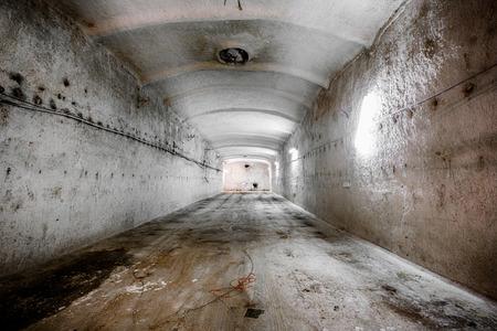 an old abandoned limestone mine corridors, poor light photo
