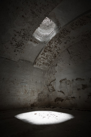 skylight window in an old limestone quarry ceiling, poor light photo