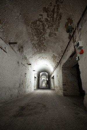 corridors: an old abandoned limestone mine corridors, poor light Stock Photo