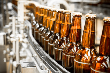 Beer bottles on the conveyor belt, brewery Stock Photo