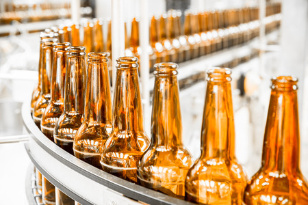 Beer bottles on the conveyor belt, brewery Zdjęcie Seryjne