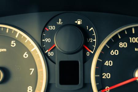 a car modern dashboard, gauge instruments, detail photo