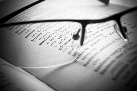 businees: an open book Dictionary letters, close up Stock Photo