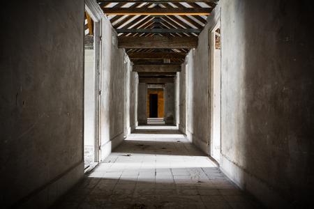 corridors: an old building corridors, doors, wooden roof structure