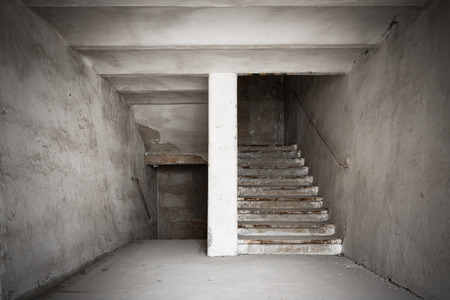 the staircase of an old desolate industrial building