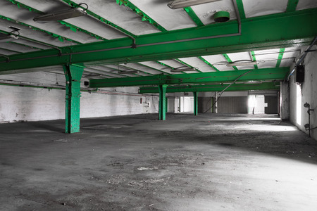 empty warehouse: an old empty industrial warehouse interior, bright light Stock Photo