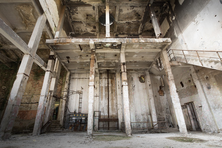 white room: an old ruined abandoned industrial building interior