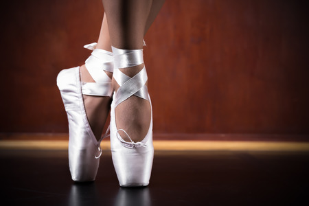black toes: Young ballerina dancing, closeup on legs and shoes