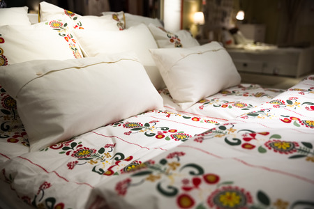 r furniture: a traditional Hungarian flower patterned bedding in the bedroom Stock Photo