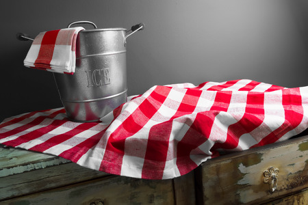 custom cabinet: empty ice bucket on a checkered tablecloth Stock Photo