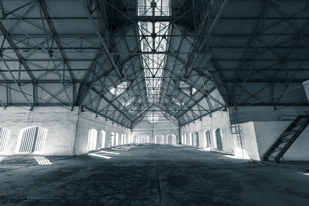 an empty desolate industrial building inside, attic photo