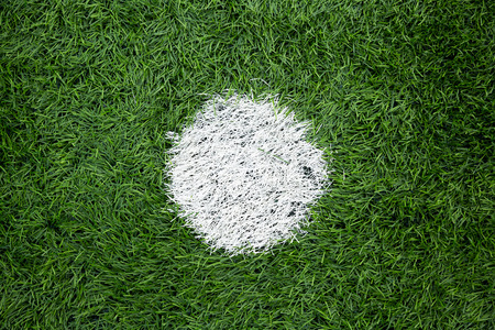 punisher dot painting on a football ground photo