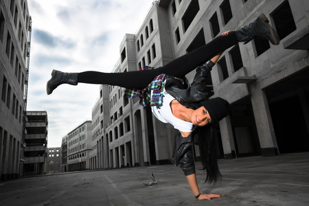 a hip-hop dancer girl posing on the deserted streets photo