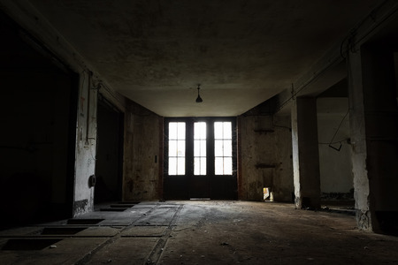 low light: Old Abandoned industrial interior with low light Stock Photo