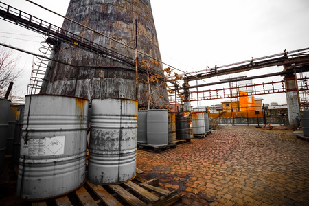 barrel containing much hazardous waste in a firm photo