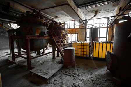 discarded metal: Industrial interior with storage tank in rusty colors