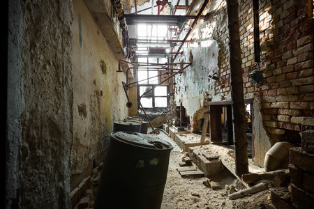 dilapidated: an old dilapidated industrial interior, poor light