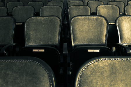 wood chairs in an old theater Standard-Bild