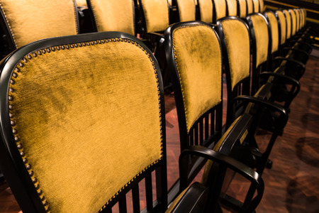 wood chairs in an old theater photo