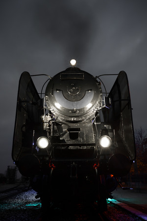 old steam train at a station before departure photo