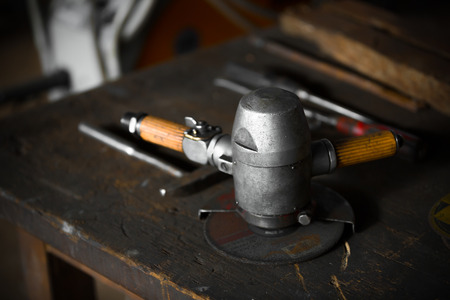 grinder machine: a grinder machine on a table in the factory Stock Photo