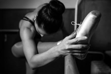 A young ballerina exercises, detail, ballet shoes