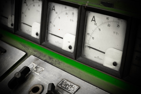control room: a electric amperage control panel, low light