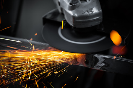 Electric wheel grinding on steel structure in factory Stok Fotoğraf