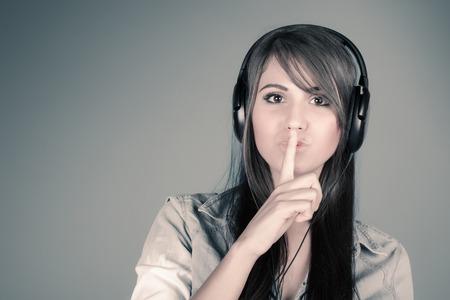 Young beautiful woman enjoying the music photo