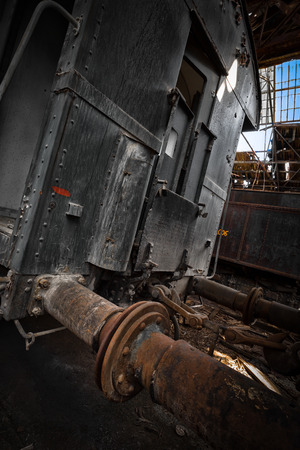 Old train wagons in an abandoned warehouse photo