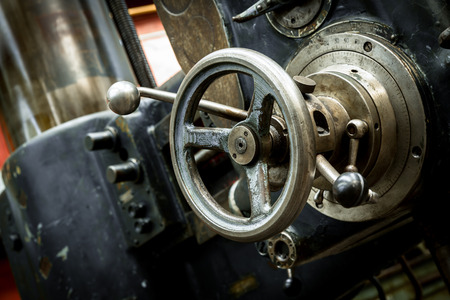 turning operation: industrial machines in a old factory