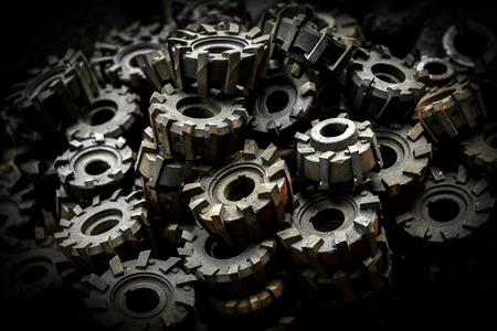 Closeup of many metal cog gears photo
