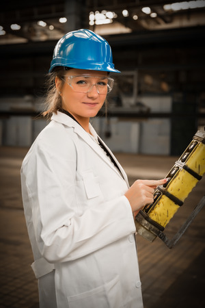 young girl worker in the factory photo