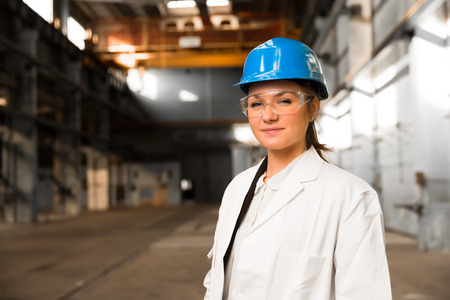 quality control: young girl worker in the factory Stock Photo
