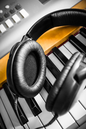 Piano keyboard with headphones for music photo
