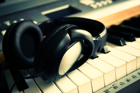 hymnal: Piano keyboard with headphones for music Stock Photo