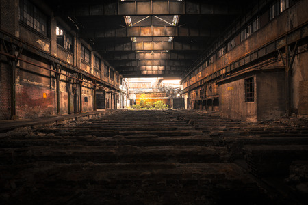 Abandoned industrial interior with bright light photo
