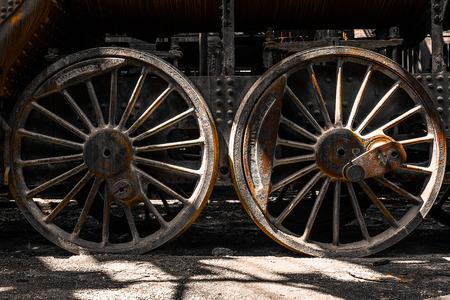Grunge old steam locomotive wheels photo