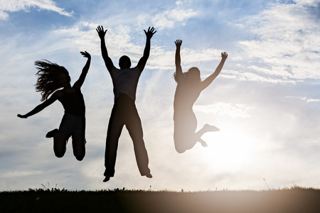 silhouette group of happy young people jump up in the park 版權商用圖片
