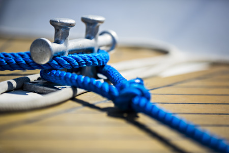 nearly: a sailing ship fixing his rope, nearly detail