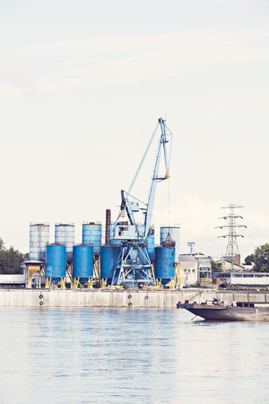 inland: an industrial plant on a river grain silos Stock Photo