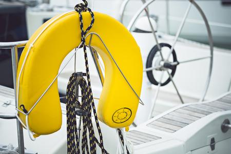 a modern sailing ship yellow life jackets