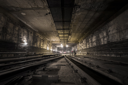 an old dirty and dark subway tunnel